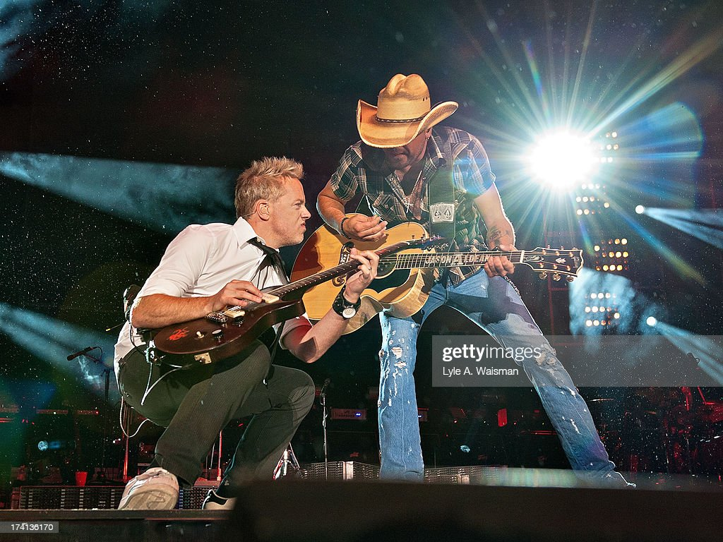 Kurt Allison and Jason Aldean perform during the Night Train Tour 2013 at Wrigley Field on July 20, 2013 in Chicago.