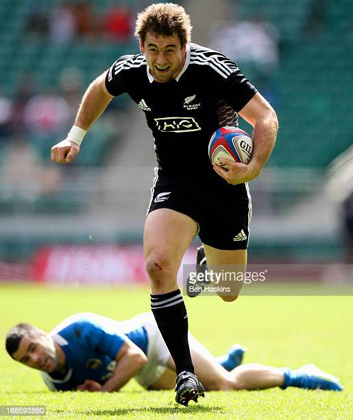 Kurt Baker of New Zealand breaks away from Gaston Revol of Argentina during the Marriott London Sevens Day Two at Twickenham on May 12 2013 in London...
