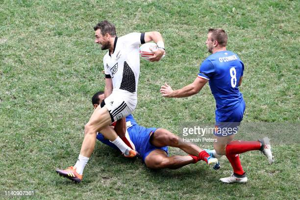 Kurt Baker of New Zealand charges forward against France on day three of the Cathay Pacific/HSBC Hong Kong Sevens at the Hong Kong Stadium on April...