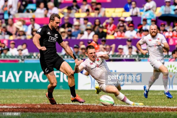 Kurt Baker of New Zealand tries to put a tackle on Will Edwards of England during the day three of the Cathay Pacific/HSBC Hong Kong Sevens match...