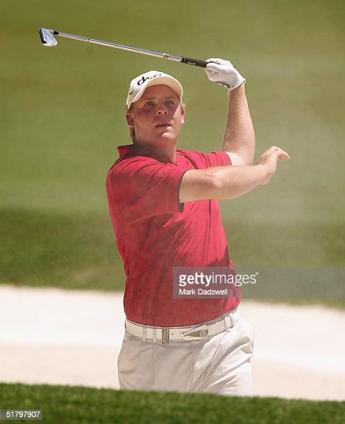 Kurt Barnes of Australia plays out of the bunker on the fifth hole during the final day of the Australian Open at the Australian Golf Club November...