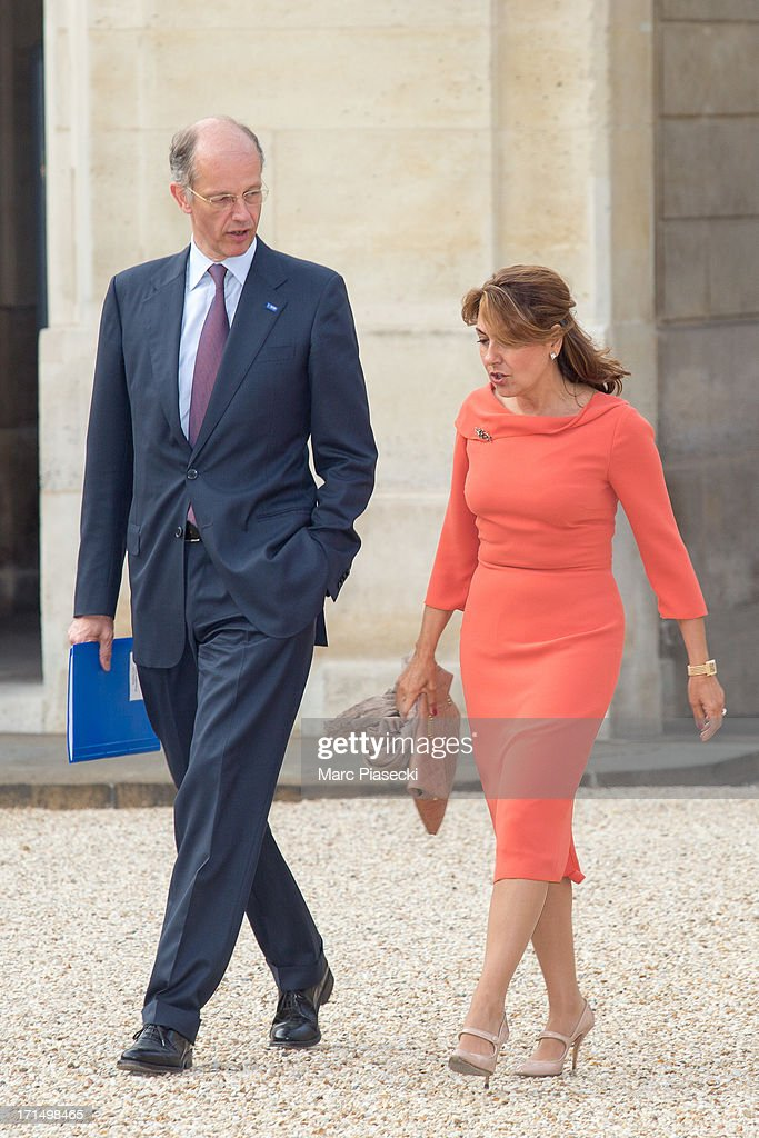 Kurt Bock, Chairman of the Board of Executive Directors, BASF SE and Arzuhan Dogan YALCINDAG, Chairman of Dogan TV Holding (DTVH) arrive to attend a dinner at Elysee Palace on June 25, 2013 in Paris, France.