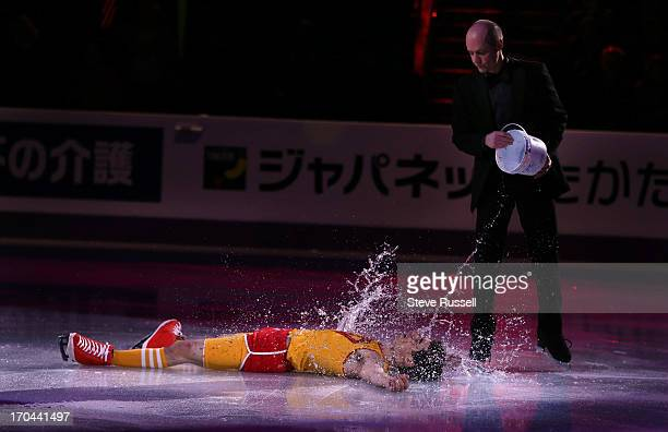 Kurt Browning helps Javier Fernandez of Spain cool down during his Aerobic Class program at the ISU World Figure Skating Championship Winners...