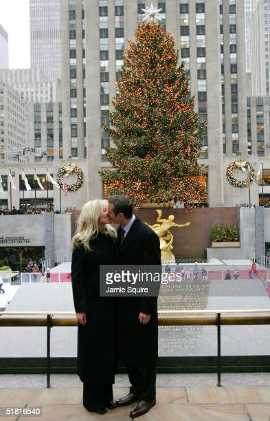Kurt Busch 2004 NASCAR NEXTEL Cup Series Champion kisses girlfriend Eva Bryan in front of the Christmas Tree in Rockefeller Center as part of the...