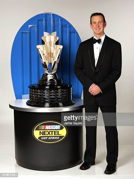 Kurt Busch, 2004 NASCAR NEXTEL Cup Series Champion, poses with the NASCAR NEXTEL Cup trophy prior to an awards banquet as part of the NASCAR NEXTEL...