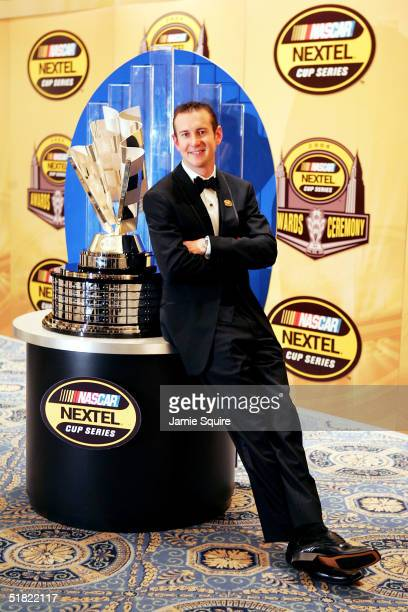 Kurt Busch 2004 NASCAR NEXTEL Cup Series Champion poses with the NASCAR NEXTEL Cup trophy after the awards banquet on December 3 2004 in New York New...