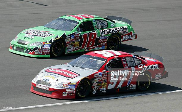 Kurt Busch and the Roush Racing Ford dices with Bobby Labonte in Joe Gibbs Racing Interstate Batteries Chevrolet during the NASCAR Winston Cup Auto...