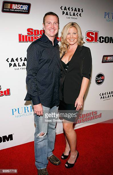 Kurt Busch and wife Eva arrive at Sports Illustrated's Club SI NASCAR at PURE Nightclub at Caesars Palace on December 3 2009 in Las Vegas Nevada
