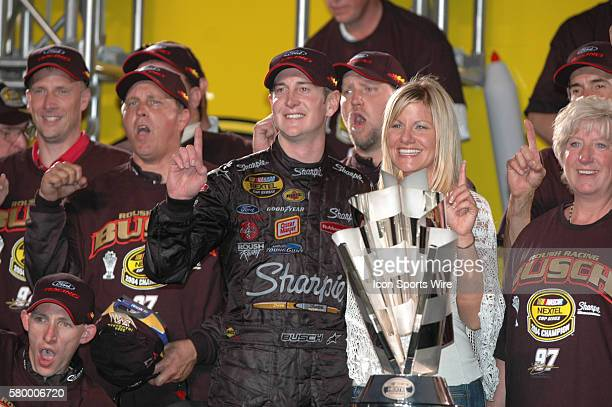 Kurt Busch celebrates winning the Nextel Cup series championship with his girlfriend Eva Bryan at the Ford 400 at HomesteadMiami Speedway in...