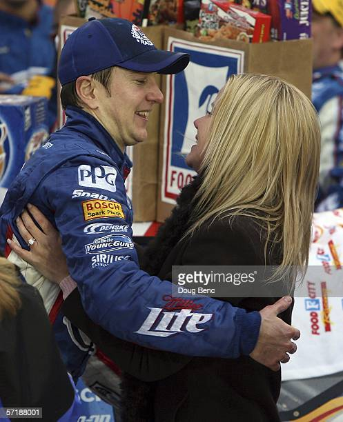 Kurt Busch driver of Miller Lite Dodge celebrates in victory lane with Eva Bryan after winning the NASCAR Nextel Cup Food City 500 on March 26 2006...