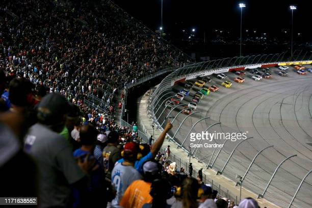 Kurt Busch driver of the Chevrolet Accessories Chevrolet leads the field during a restart for the Monster Energy NASCAR Cup Series Bojangles'...