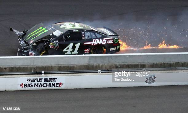 Kurt Busch driver of the Ford wrecks during the Monster Energy NASCAR Cup Series Brickyard 400 at Indianapolis Motorspeedway on July 23 2017 in...