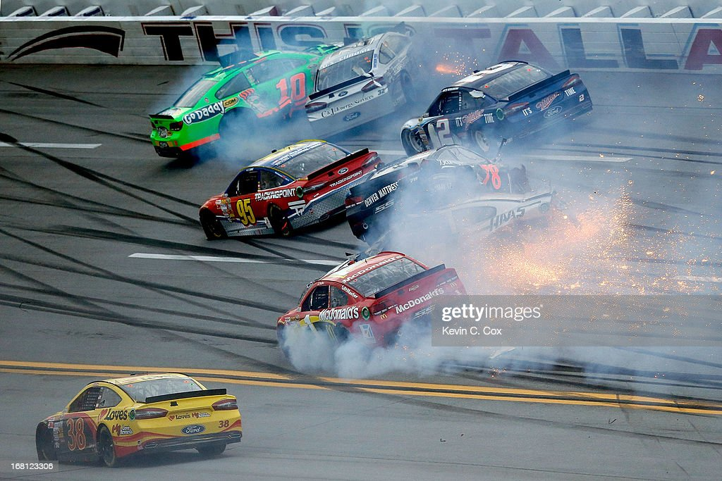 Kurt Busch, driver of the #78 Furniture Row / Beautyrest Chevrolet, flips and falls on top of Ryan Newman, driver of the #39 Haas Automation Chevrolet, during the NASCAR Sprint Cup Series Aaron's 499 at Talladega Superspeedway on May 5, 2013 in Talladega, Alabama.