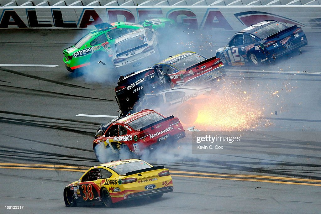 Kurt Busch, driver of the #78 Furniture Row / Beautyrest Chevrolet, flips and falls on top of Ryan Newman, driver of the #39 Haas Automation Chevrolet, following an incident during the NASCAR Sprint Cup Series Aaron's 499 at Talladega Superspeedway on May 5, 2013 in Talladega, Alabama.
