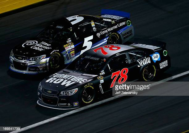 Kurt Busch driver of the Furniture Row Racing Chevrolet races with Kasey Kahne driver of the Time Warner Cable Chevrolet during the NASCAR Sprint Cup...
