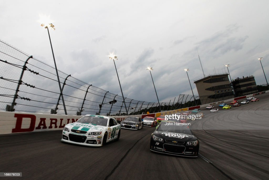 Kurt Busch, driver of the #78 Furniture Row Racing / Serta Chevrolet, and Jimmie Johnson, driver of the #48 Lowe's Emerald Green Chevrolet, lead the field before the start of the NASCAR Sprint Cup Series Bojangles' Southern 500 at Darlington Raceway on May 11, 2013 in Darlington, South Carolina.