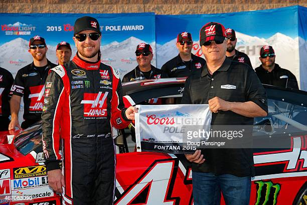 Kurt Busch , driver of the Haas Automation Chevrolet, and Gene Haas, co-owner of Stewart-Haas Racing, pose with the Coors Light Pole Award after...