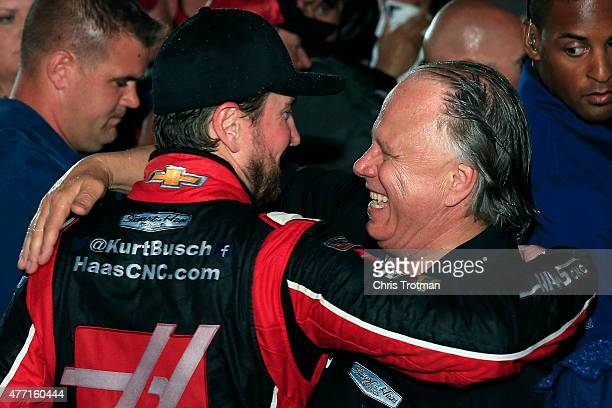 Kurt Busch, driver of the Haas Automation Chevrolet, and Gene Haas, co-owner of Stewart Haas Racing, celebrate in an alternate Victory Lane after...