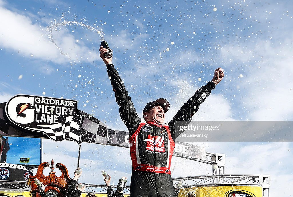 Kurt Busch, driver of the #41 Haas Automation Chevrolet, celebrates in Victory Lane after winning the NASCAR Sprint Cup Series STP 500 at Martinsville Speedway on March 30, 2014 in Martinsville, Virginia.