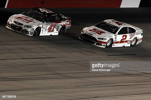 Kurt Busch driver of the Haas Automation Chevrolet leads Brad Keselowski driver of the Miller High Life Ford during the NASCAR Sprint Cup Series...