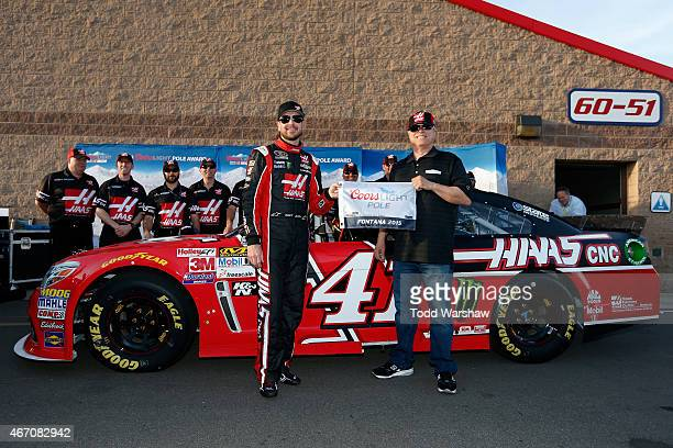 Kurt Busch , driver of the Haas Automation Chevrolet, poses for a photo with Gene Haas, co-owner of Stewart-Haas Racing, after winning the pole...
