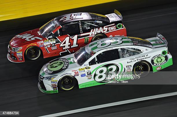 Kurt Busch driver of the Haas Automation Chevrolet races Matt DiBenedetto driver of the Dustless Blasting Toyota during the NASCAR Sprint Cup Series...