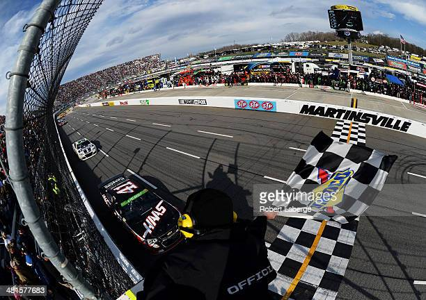 Kurt Busch driver of the Haas Automation Chevrolet races to the checkered flag to win the NASCAR Sprint Cup Series STP 500 at Martinsville Speedway...