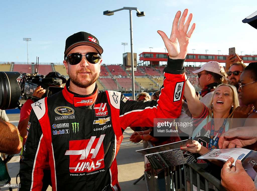 Kurt Busch, driver of the #41 Haas Automation Chevrolet, reacts after qualifying on the pole for the NASCAR Sprint Cup Series Auto Club 400 at Auto Club Speedway on March 20, 2015 in Fontana, California.