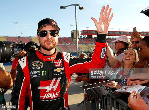 Kurt Busch driver of the Haas Automation Chevrolet reacts after qualifying on the pole for the NASCAR Sprint Cup Series Auto Club 400 at Auto Club...