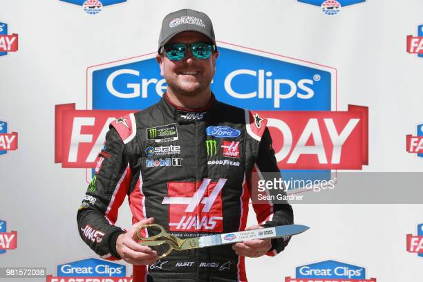 Kurt Busch driver of the Haas Automation Ford poses with the Great Clips Fast Friday award after posting the fastest lap during practice for the...