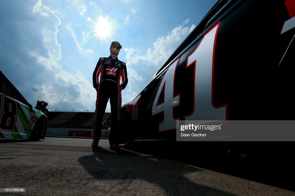Kurt Busch, driver of the #41 Haas Automation Ford, stands on the grid during qualifying for the Monster Energy NASCAR Cup Series Consmers Energy 400 at Michigan International Speedway on August 10, 2018 in Brooklyn, Michigan.