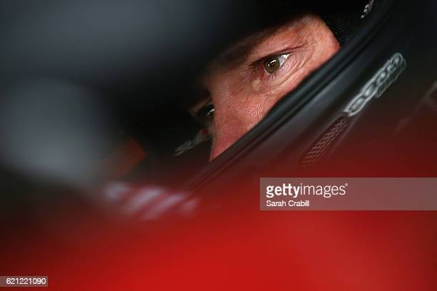 Kurt Busch, driver of the Haas Automation/Monster Energy Chevrolet, sits in his car during practice for the NASCAR Sprint Cup Series AAA Texas 500 at...