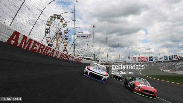 Kurt Busch driver of the Haas Automation/Monster Energy Ford and AJ Allmendinger driver of the Kroger ClickList Chevrolet lead the field at the start...