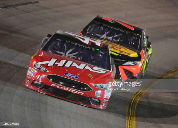 Kurt Busch driver of the Haas Automation/Monster Energy Ford and Martin Truex Jr driver of the Bass Pro Shops/5hour ENERGY Toyota race during the...