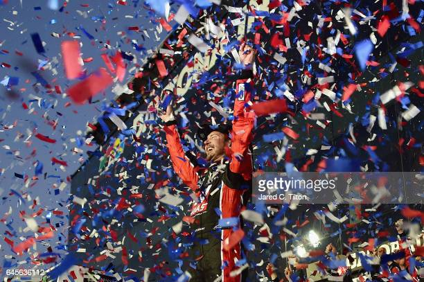 Kurt Busch driver of the Haas Automation/Monster Energy Ford celebrates in Victory Lane after winning the 59th Annual DAYTONA 500 at Daytona...