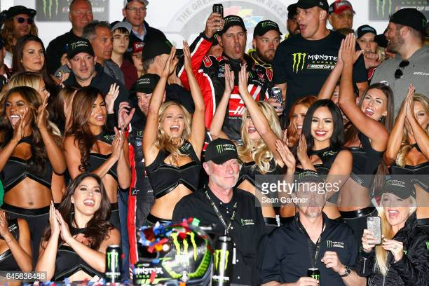 Kurt Busch driver of the Haas Automation/Monster Energy Ford celebrates in Victory Lane with Monster Energy Girls after winning the 59th Annual...