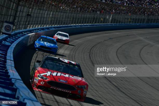 Kurt Busch driver of the Haas Automation/Monster Energy Ford leads a pack of cars during the Monster Energy NASCAR Cup Series Auto Club 400 at Auto...