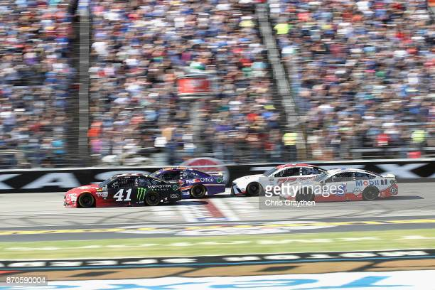 Kurt Busch driver of the Haas Automation/Monster Energy Ford leads the field past the green flag to start the Monster Energy NASCAR Cup Series AAA...