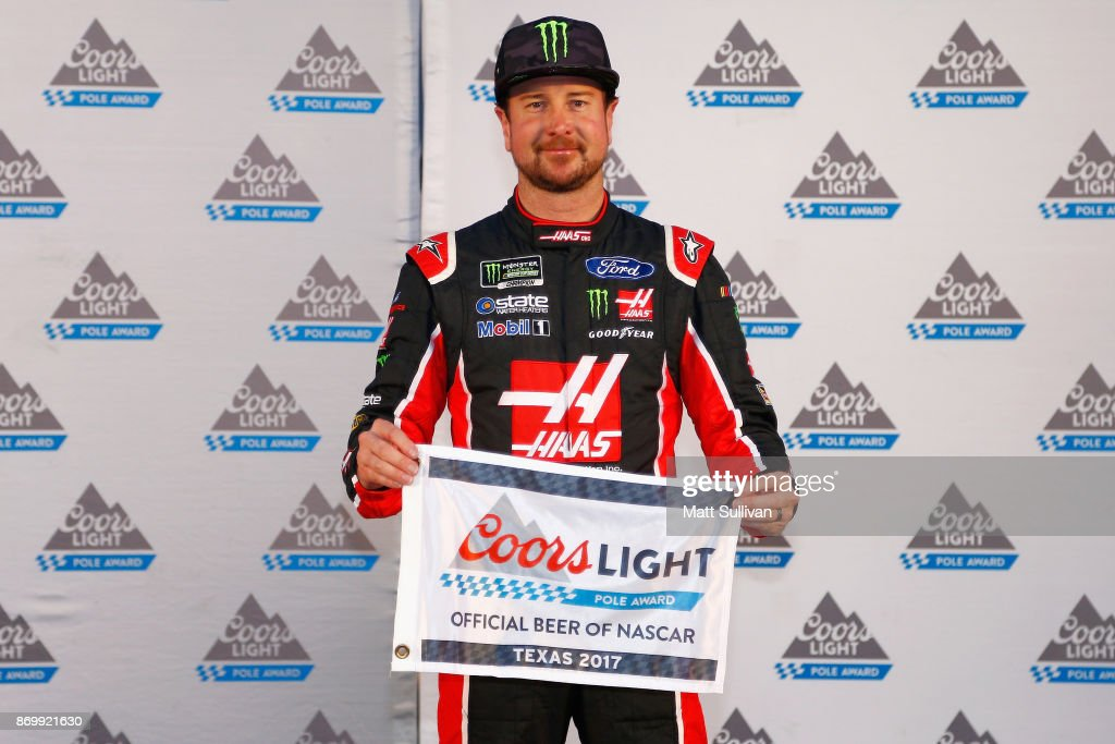 Kurt Busch, driver of the #41 Haas Automation/Monster Energy Ford, poses with the Coors Light Pole Award after qualifying for the pole position for the Monster Energy NASCAR Cup Series AAA Texas 500 at Texas Motor Speedway on November 3, 2017 in Fort Worth, Texas.