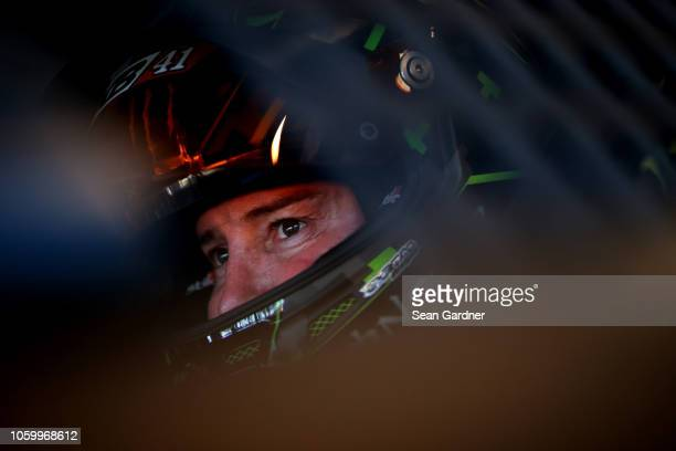 Kurt Busch driver of the Haas Automation/Monster Energy Ford sits in his car during practice for the Monster Energy NASCAR Cup Series CanAm 500 at...