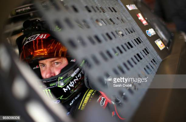 Kurt Busch driver of the Haas Automation/Monster Energy Ford sits in his car during practice for the Monster Energy NASCAR Cup Series Auto Club 400...