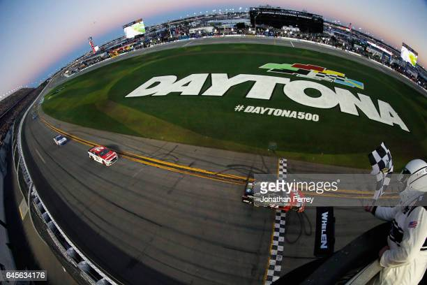 Kurt Busch driver of the Haas Automation/Monster Energy Ford takes the checkered flag to win the 59th Annual DAYTONA 500 at Daytona International...