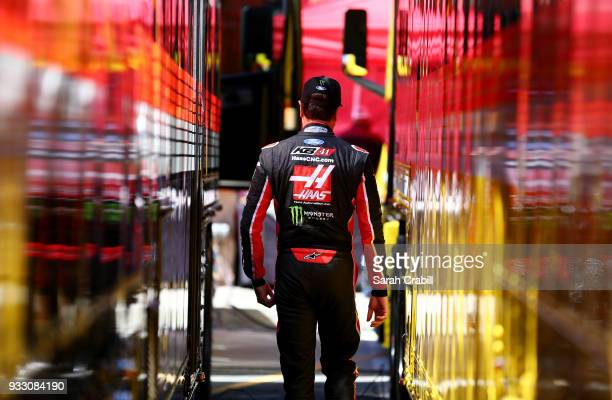 Kurt Busch driver of the Haas Automation/Monster Energy Ford walks in the garage area during practice for the Monster Energy NASCAR Cup Series Auto...