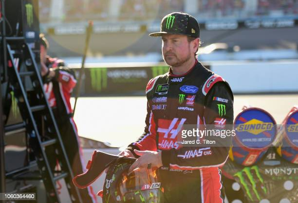 Kurt Busch driver of the Haas Automation/Monster Energy Ford walks away from pit road following an ontrack incident during the Monster Energy NASCAR...