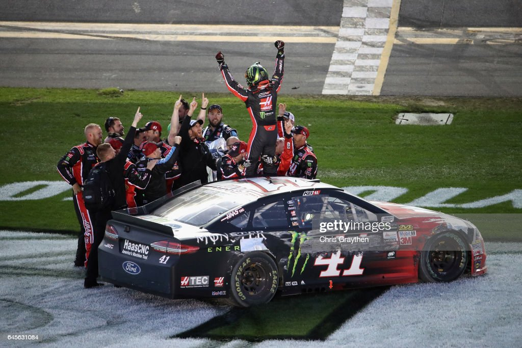Kurt Busch, driver of the #41 Haas Automation/Monster Energy Ford, celebrates with his crew after winning the 59th Annual DAYTONA 500 at Daytona International Speedway on February 26, 2017 in Daytona Beach, Florida.