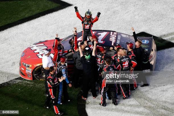 Kurt Busch driver of the Haas Automation/Monster Energy Ford celebrates with his crew after winning the 59th Annual DAYTONA 500 at Daytona...