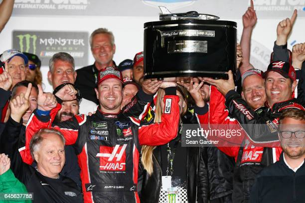 Kurt Busch driver of the Haas Automation/Monster Energy Ford celebrates with the trophy in Victory Lane after winning the 59th Annual DAYTONA 500 at...