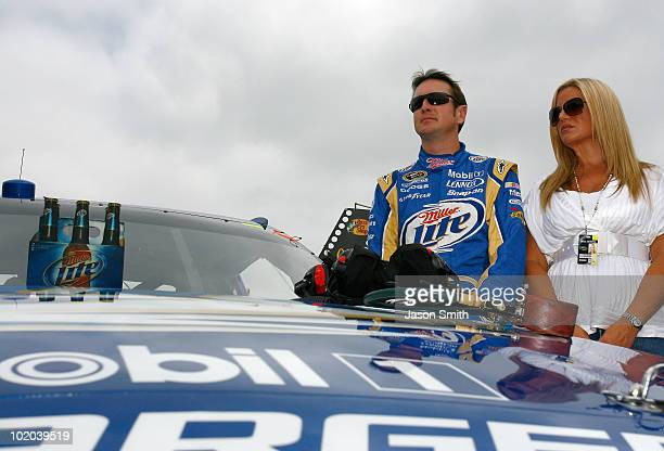 Kurt Busch driver of the Miller Lite Dodge and his wife Eva stand on the grid prior to the start of the NASCAR Sprint Cup Series Heluva Good Sour...