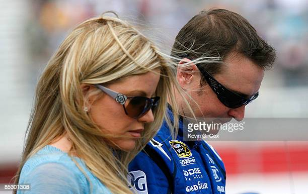 Kurt Busch driver of the Miller Lite Dodge and his wife Eva stand on pit road prior to the start of the NASCAR Sprint Cup Series Kobalt Tools 500 at...