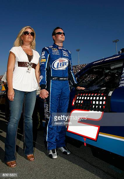 Kurt Busch driver of the Miller Lite Dodge and wife Eva stand on the grid during the national anthem for the NASCAR Sprint Cup Series Pepsi 500 at...